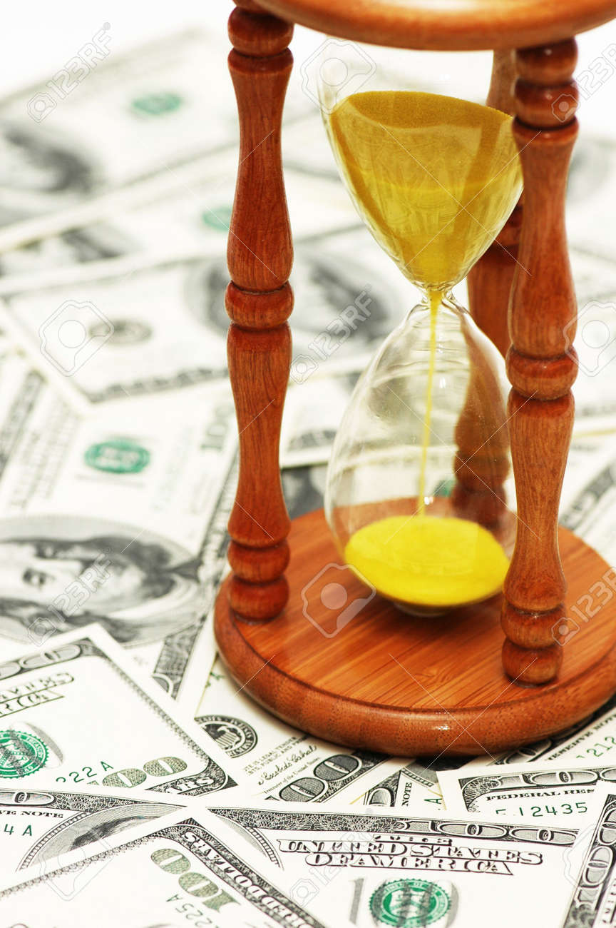 Time is money with dollar notes and  hourglass Stock Photo - 3415047