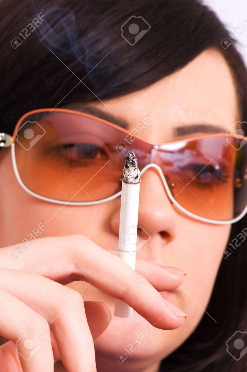 Health issues concept - Young girl smoking cigarette Stock Photo - 3481665