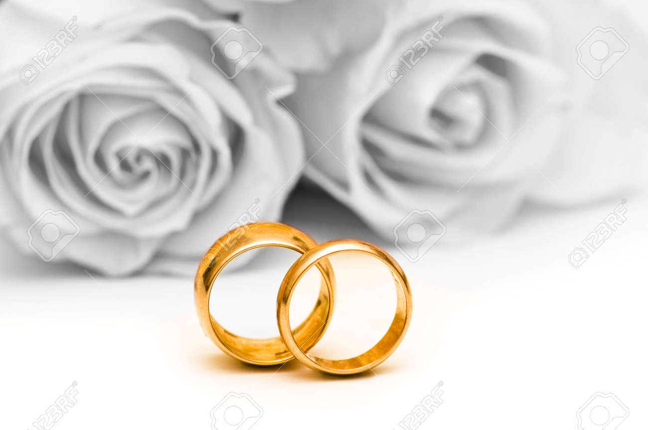 Roses and wedding ring isolated on the white Stock Photo - 4159124