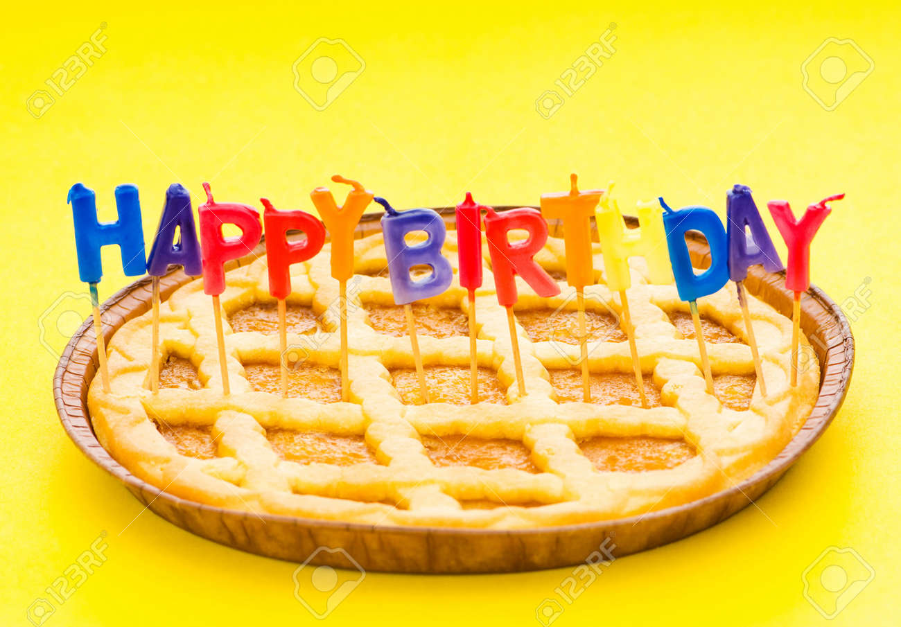 Happy birthday candles in the pie Stock Photo - 5778379