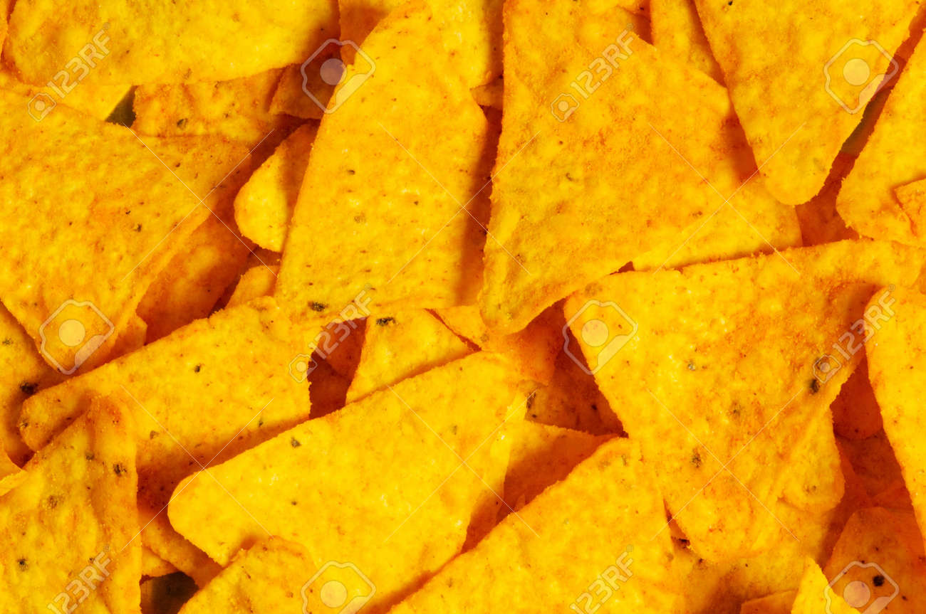 Heap of chips arranged on background Stock Photo - 5963016