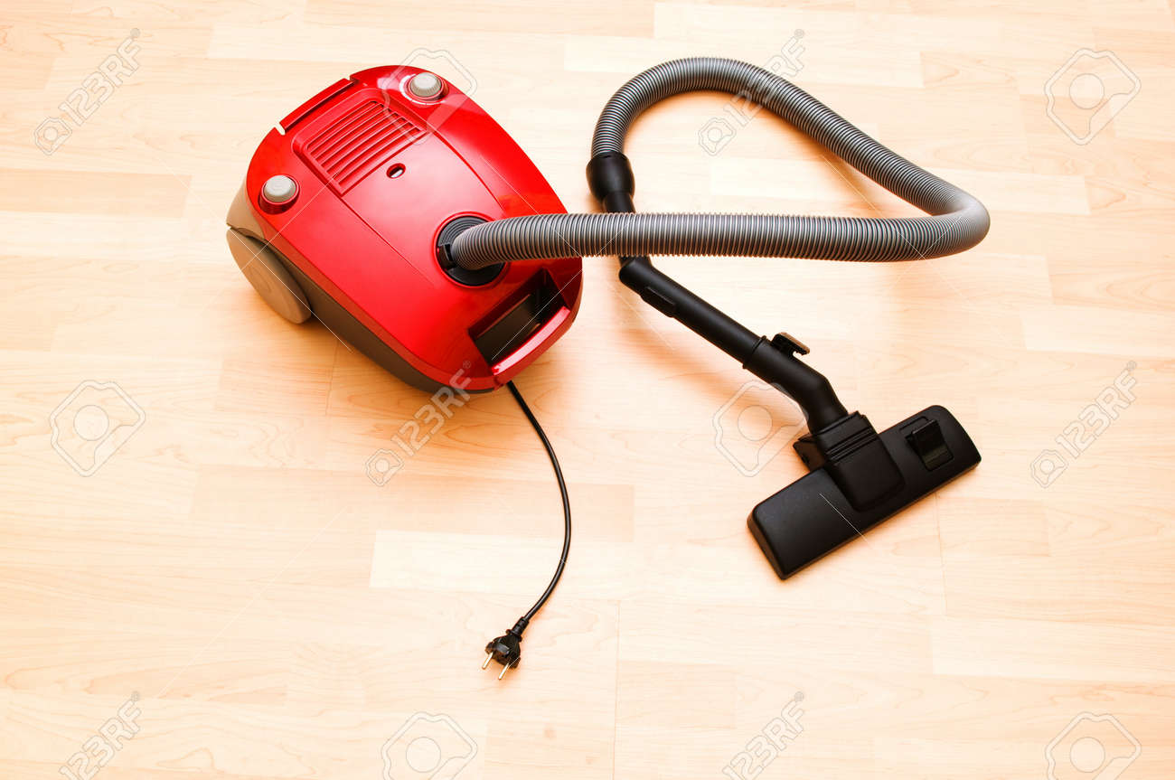 Vacuum cleaner on the wooden floor Stock Photo - 7045802