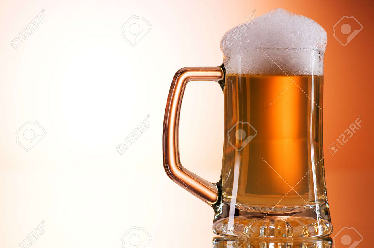 Beer glasses against the colorful gradient background Stock Photo - 7444089
