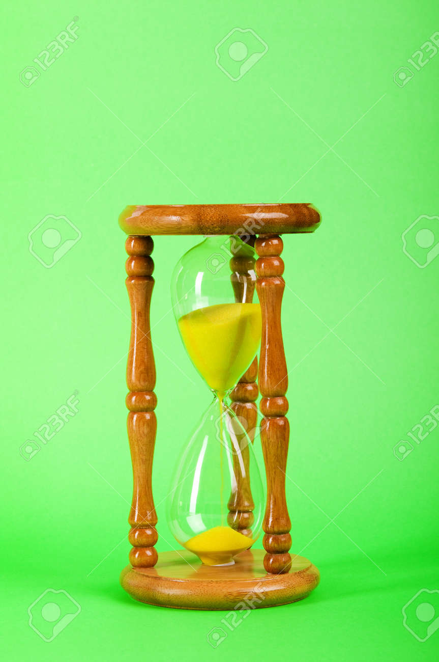 Time concept - hourglass against the gradient background Stock Photo - 7915018