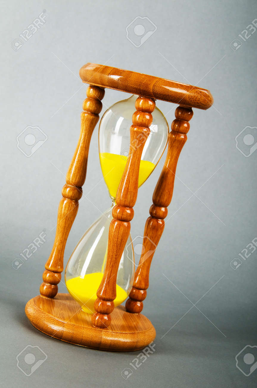 Time concept - hourglass against the gradient background Stock Photo - 7915192
