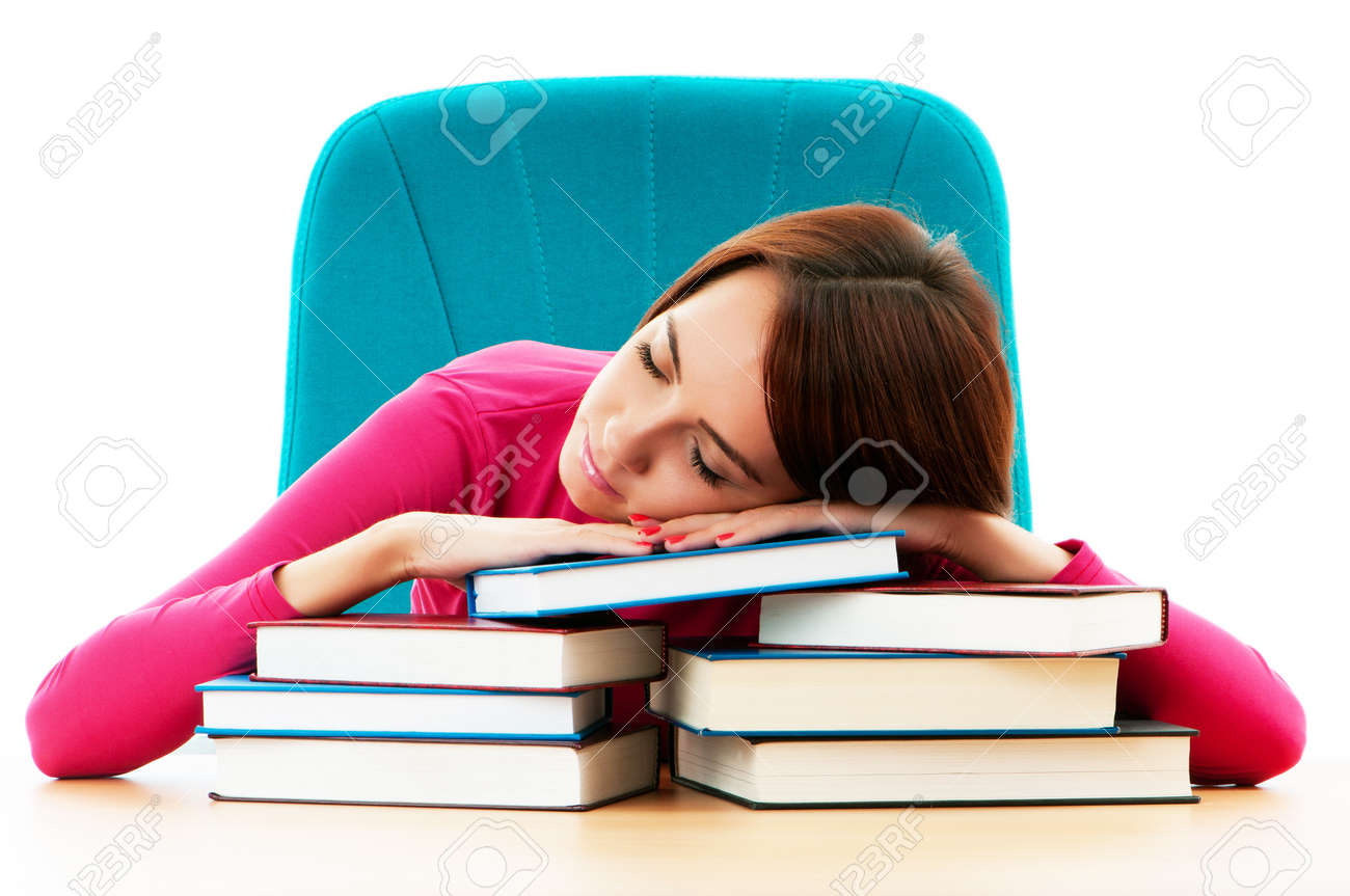 Young female student with many study books Stock Photo - 8400557