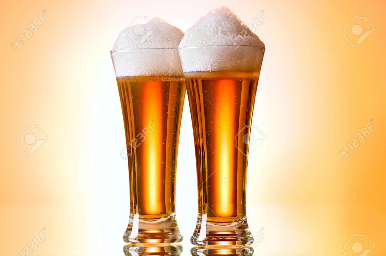 Beer glasses against the colorful gradient background Stock Photo - 8459993