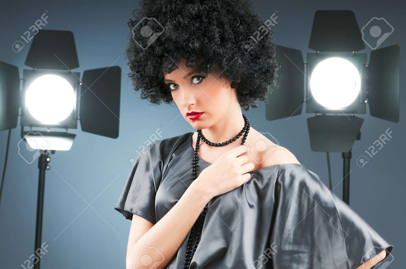 Young attractive girl with afro curly haircut Stock Photo - 8616524