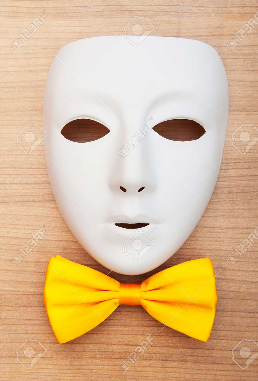 Masks and bow ties on the wooden background Stock Photo - 8616372