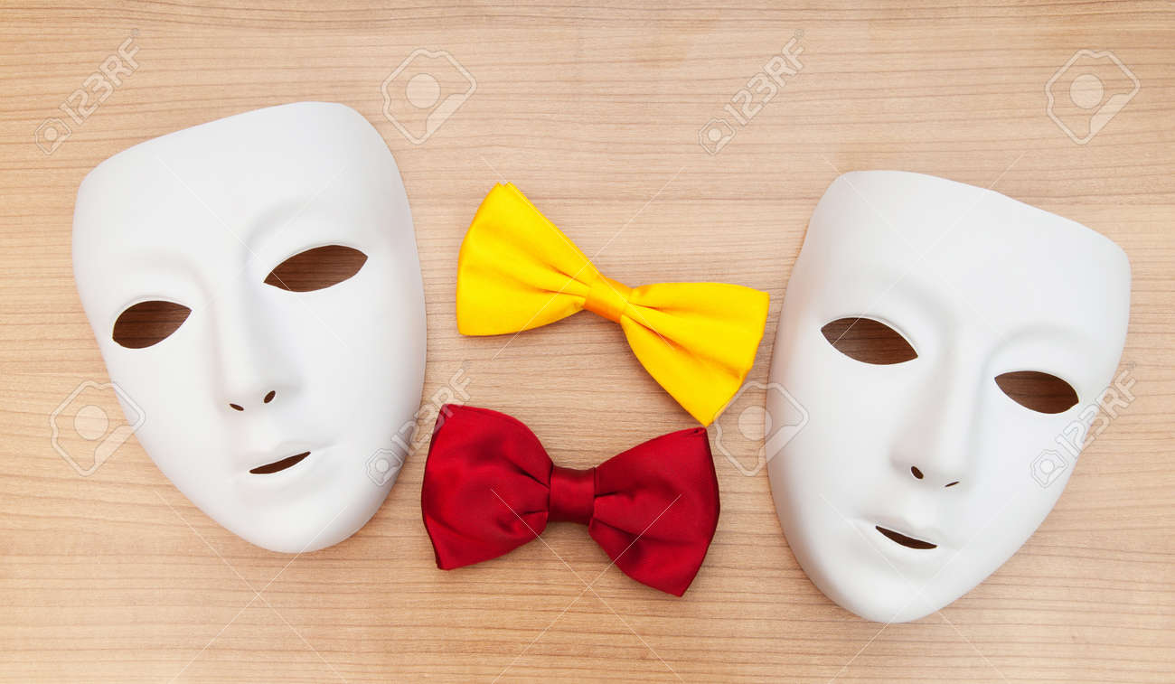 Masks and bow ties on the wooden background Stock Photo - 8616211