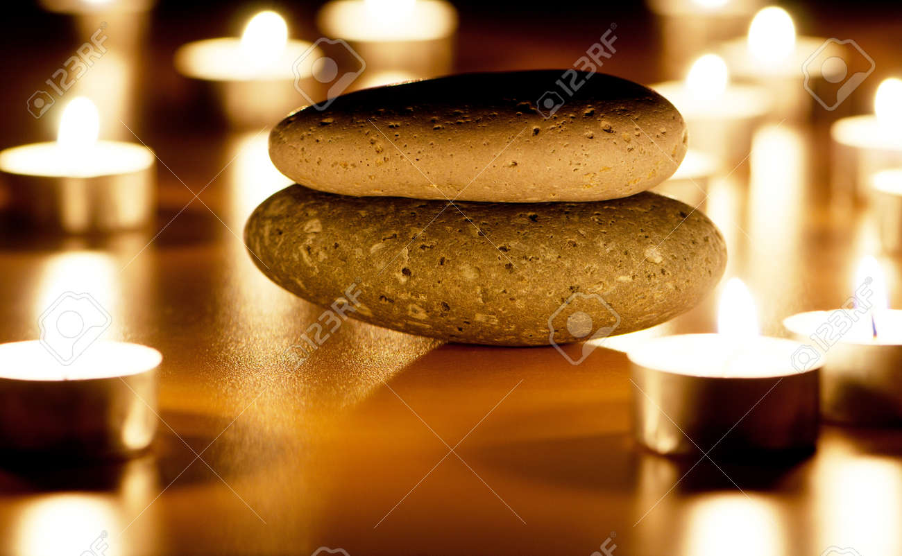 Burning candles and pebbles for aromatherapy session Stock Photo - 8657245