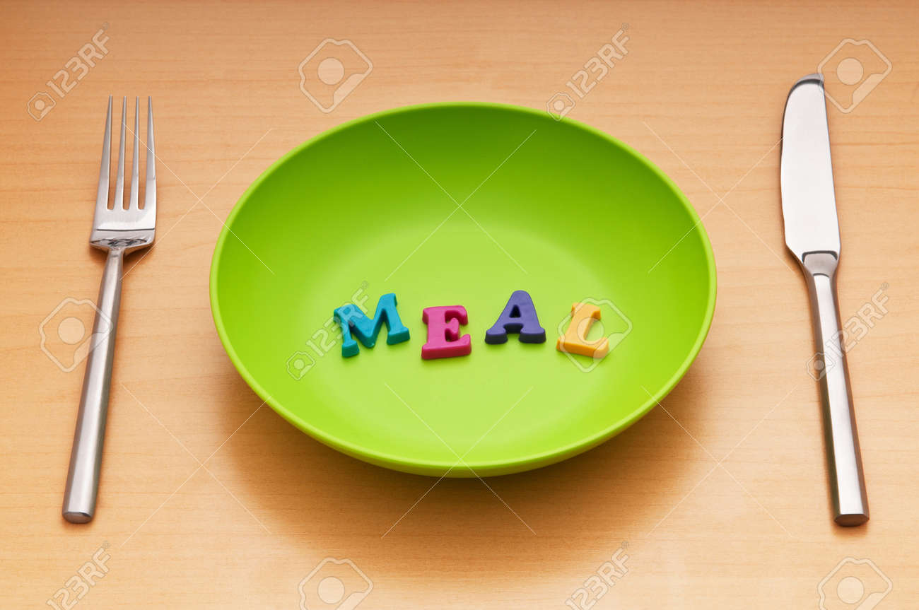 Plate with letters on the white background Stock Photo - 9487729