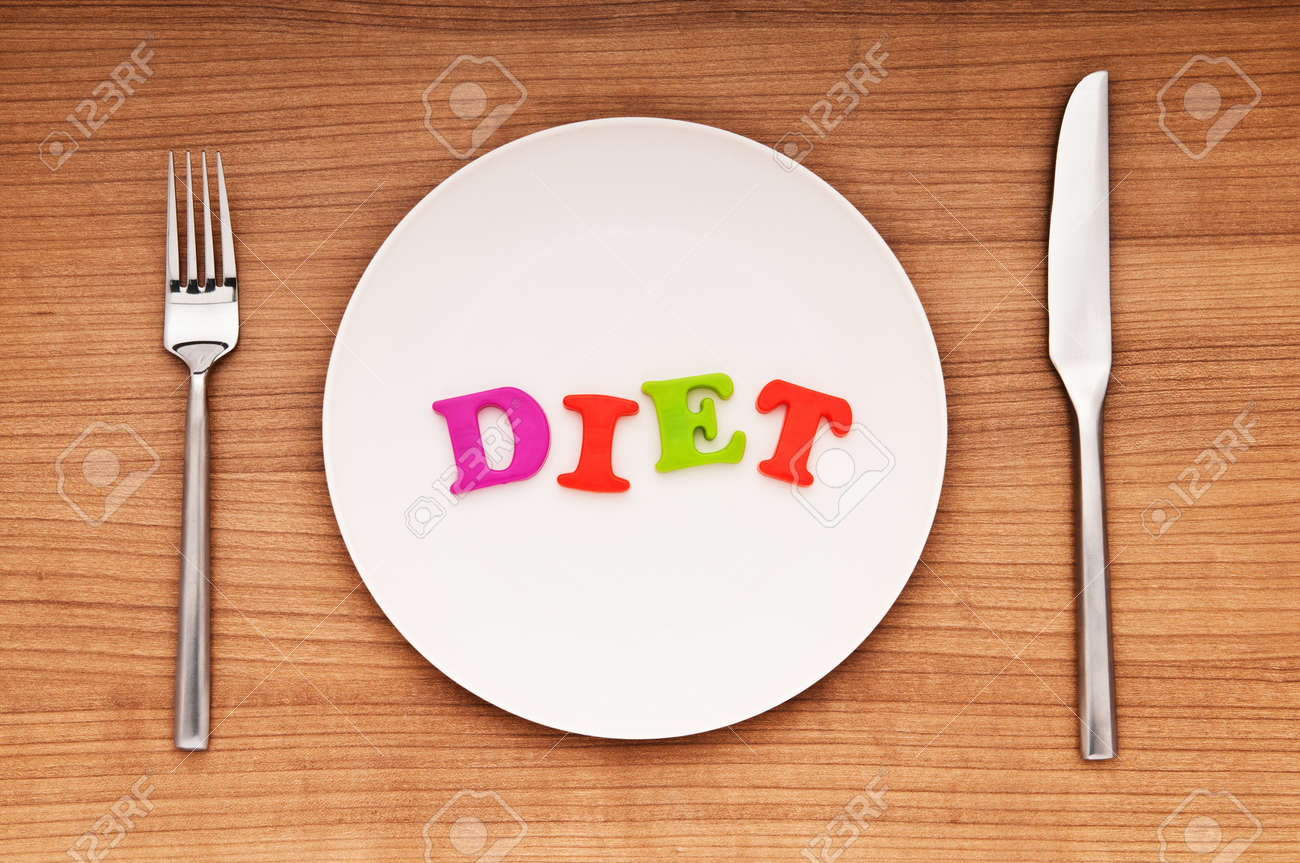 Plate with letters on the white background Stock Photo - 9487207