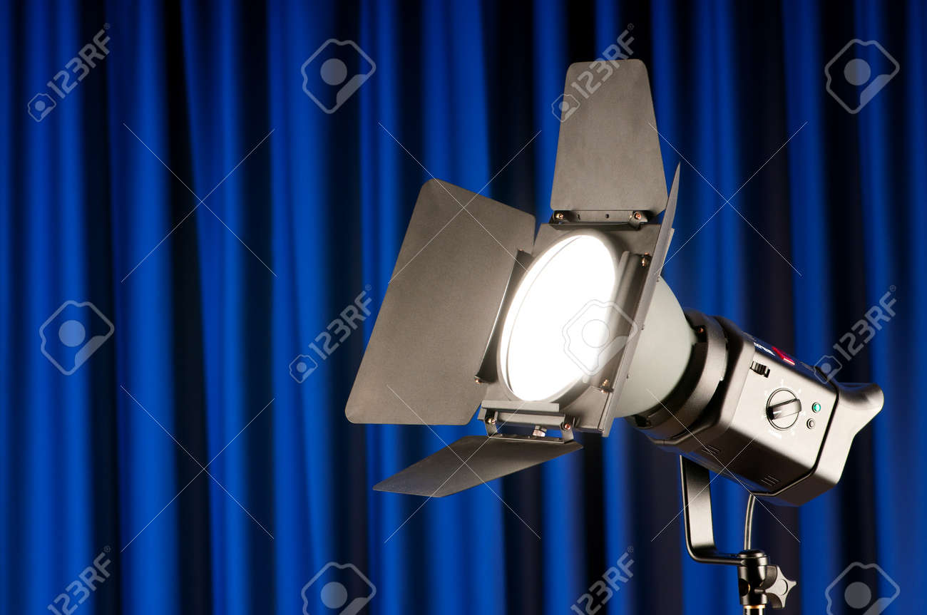 Curtains and projector lights wtih space for your text Stock Photo - 9541913