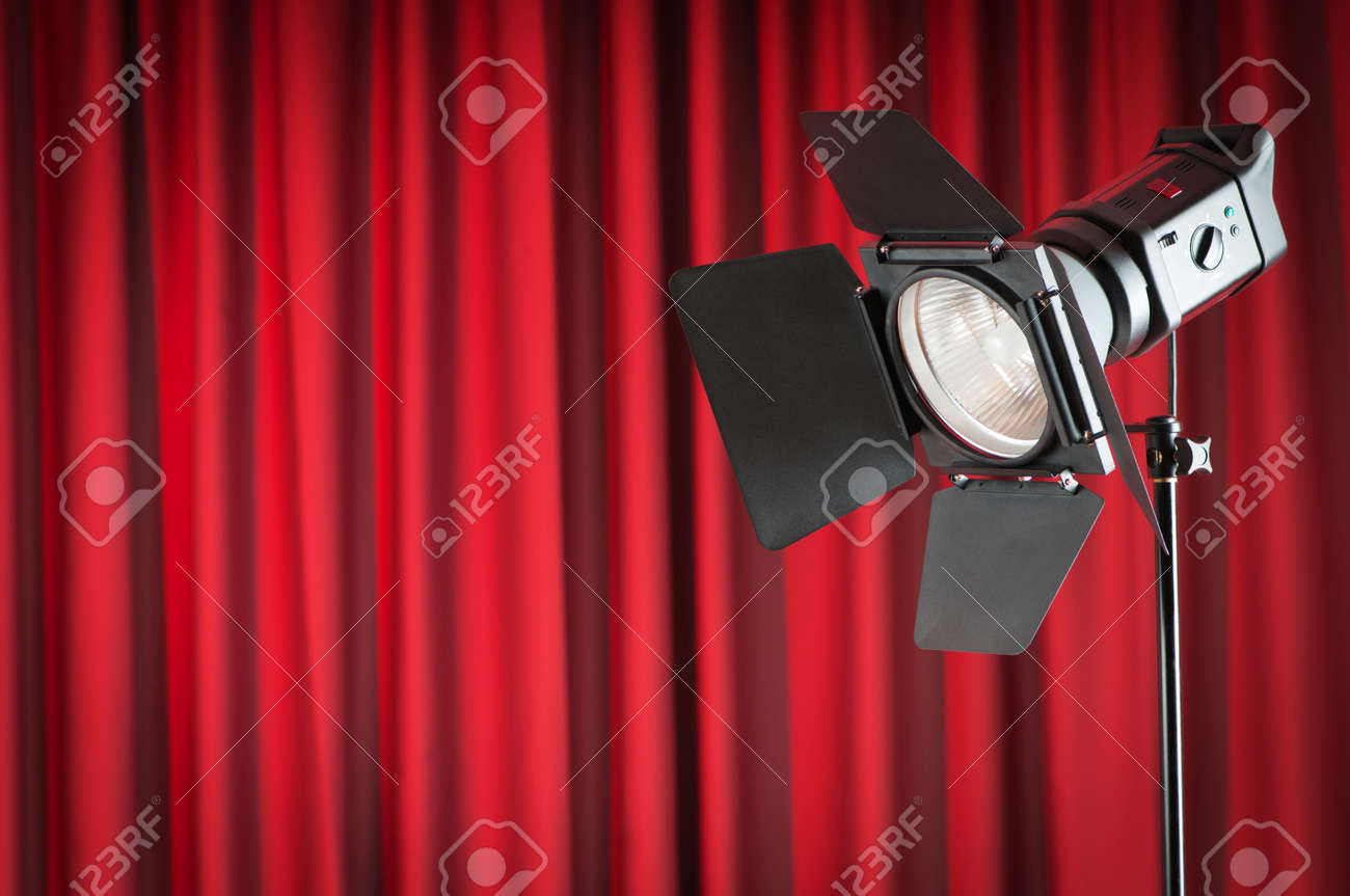 Curtains and projector lights wtih space for your text Stock Photo - 9548115
