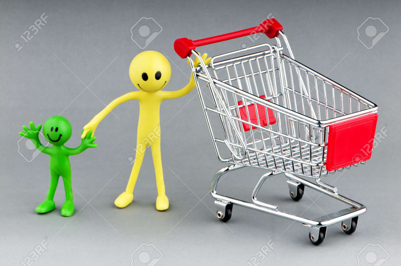 Happy family with shopping cart Stock Photo - 9590149