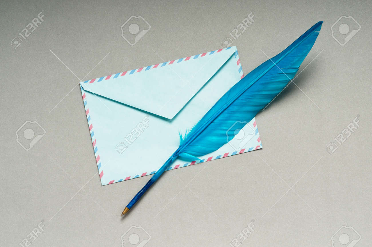 Letter and feathe isolated on the white Stock Photo - 9715579