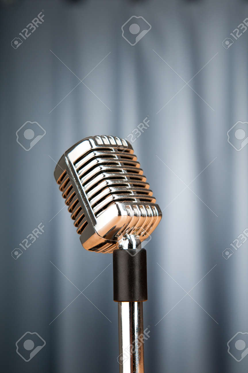 Audio microphone against the background Stock Photo - 9917868