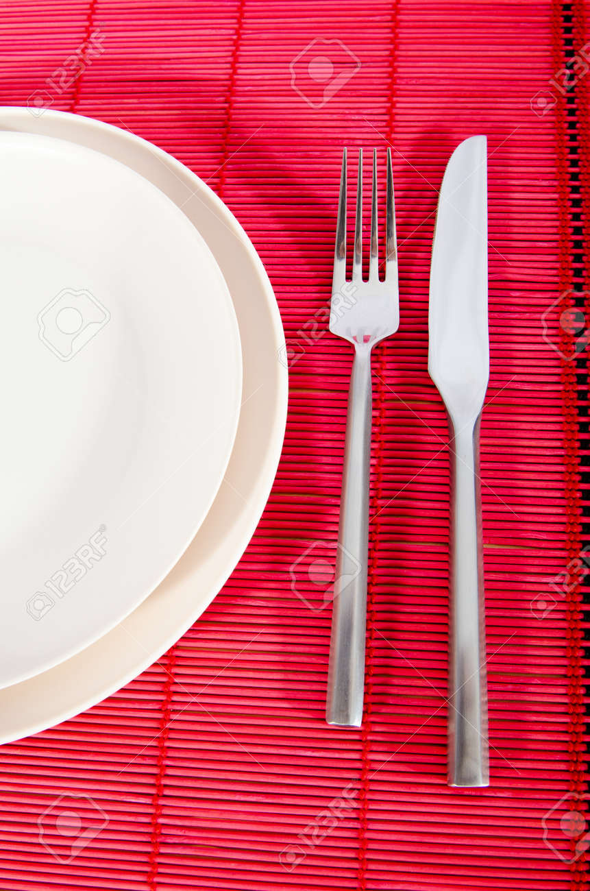 Empty plate with utensils Stock Photo - 10957993