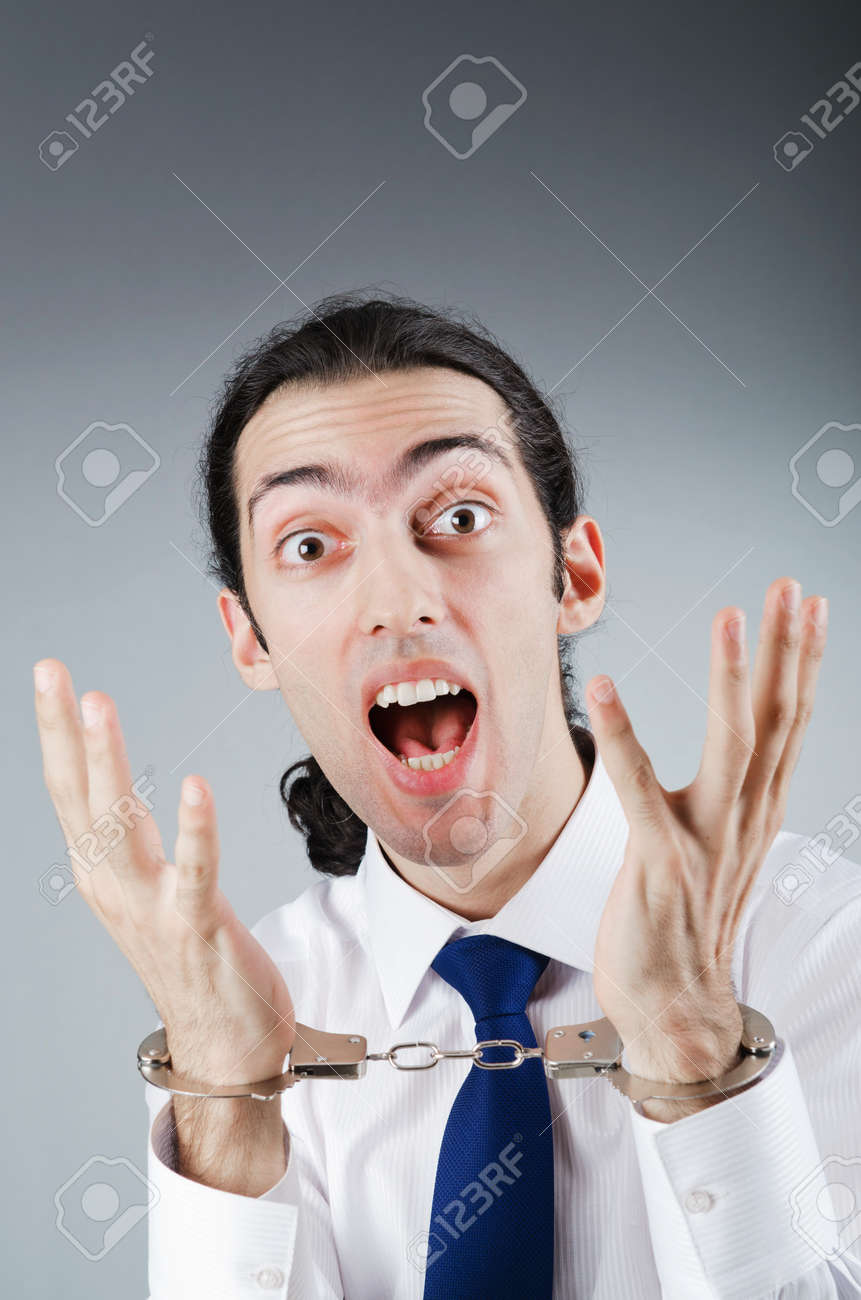Businessman handcuffed for his crimes Stock Photo - 10969698