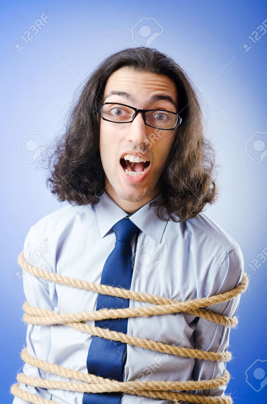 Young businessman tied with rope Stock Photo - 10969660