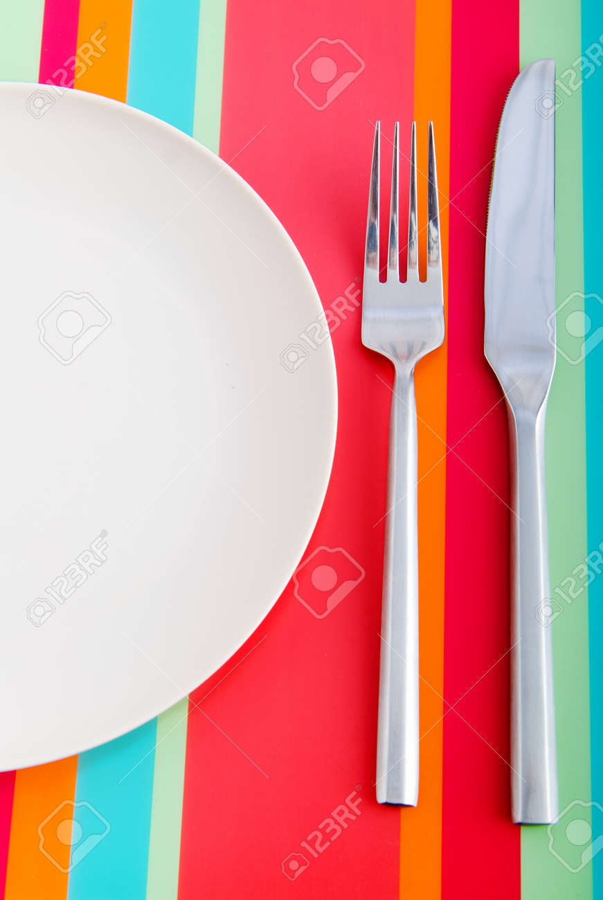 Empty plate with utensils Stock Photo - 11138052