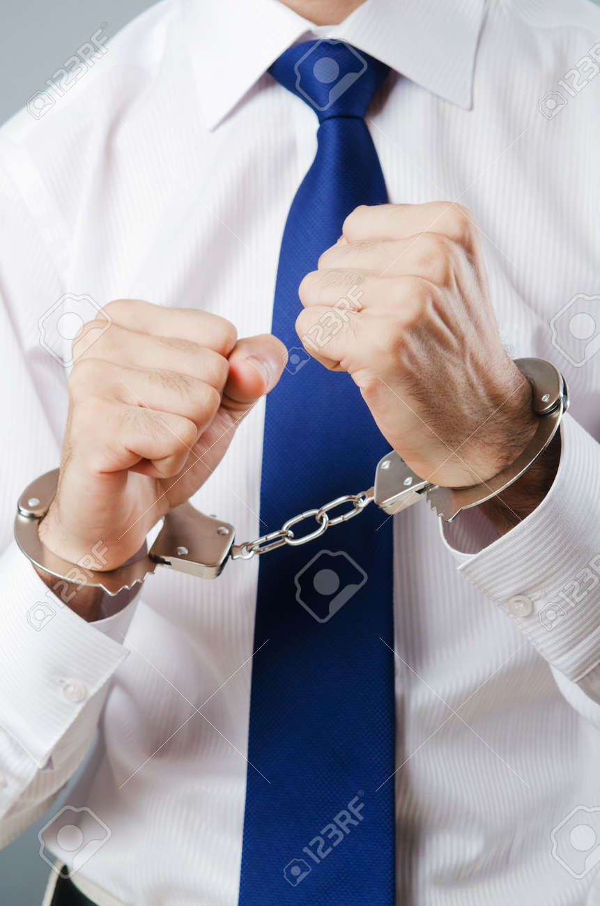 Businessman handcuffed for his crimes Stock Photo - 11130103