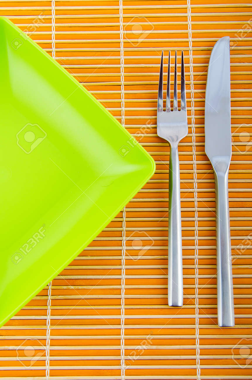 Empty plate with utensils Stock Photo - 11181205