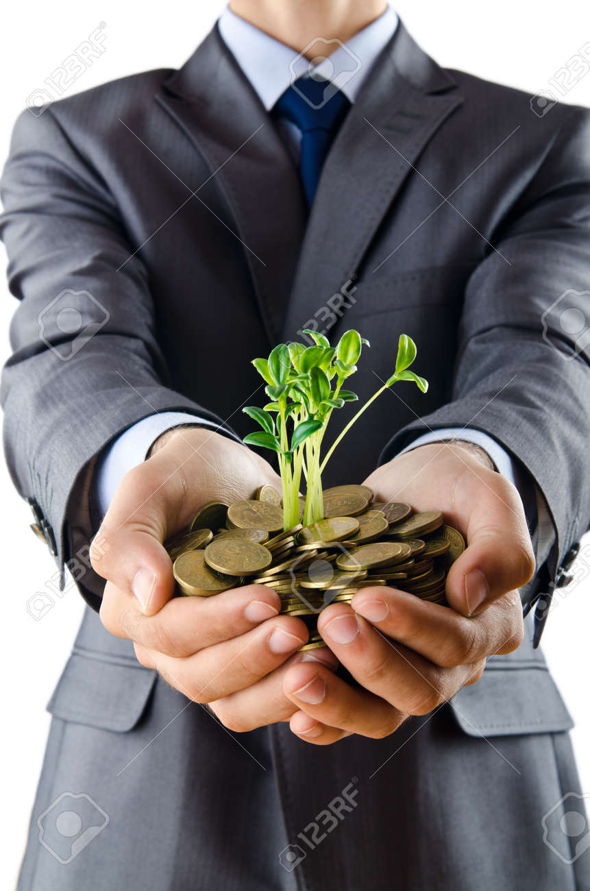 Businessman with gold seedlings and coins Stock Photo - 11243158