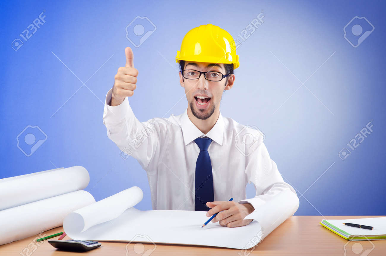 Young engineer looking at drawings Stock Photo - 11622108