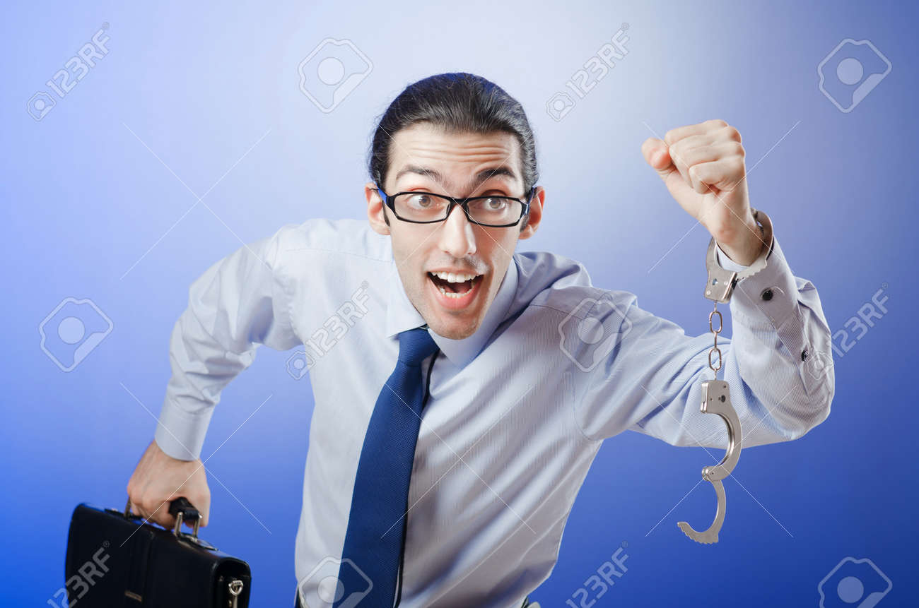 Businessman handcuffed for his crimes Stock Photo - 11587991