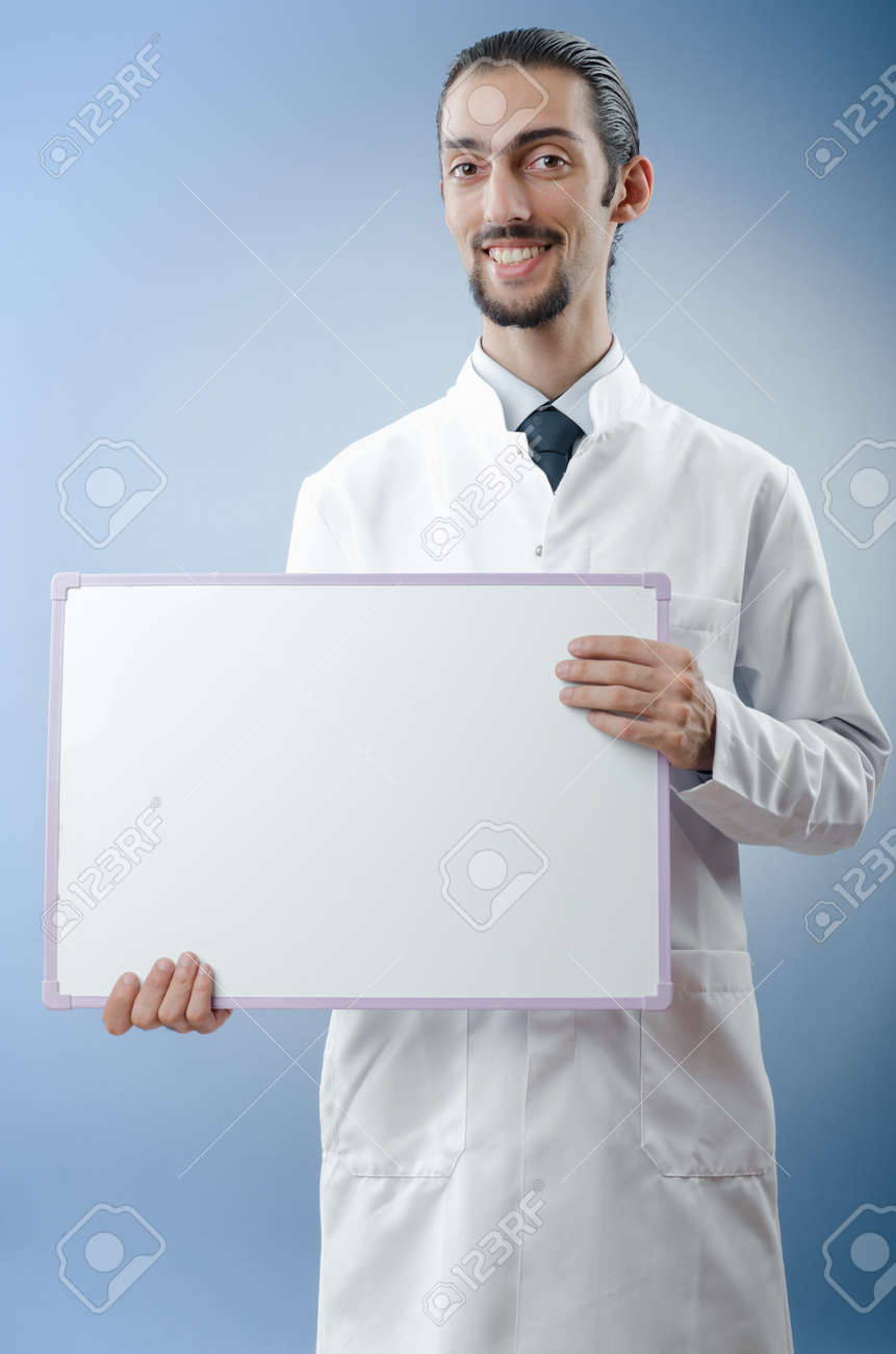 Doctor with blank message board Stock Photo - 12283690