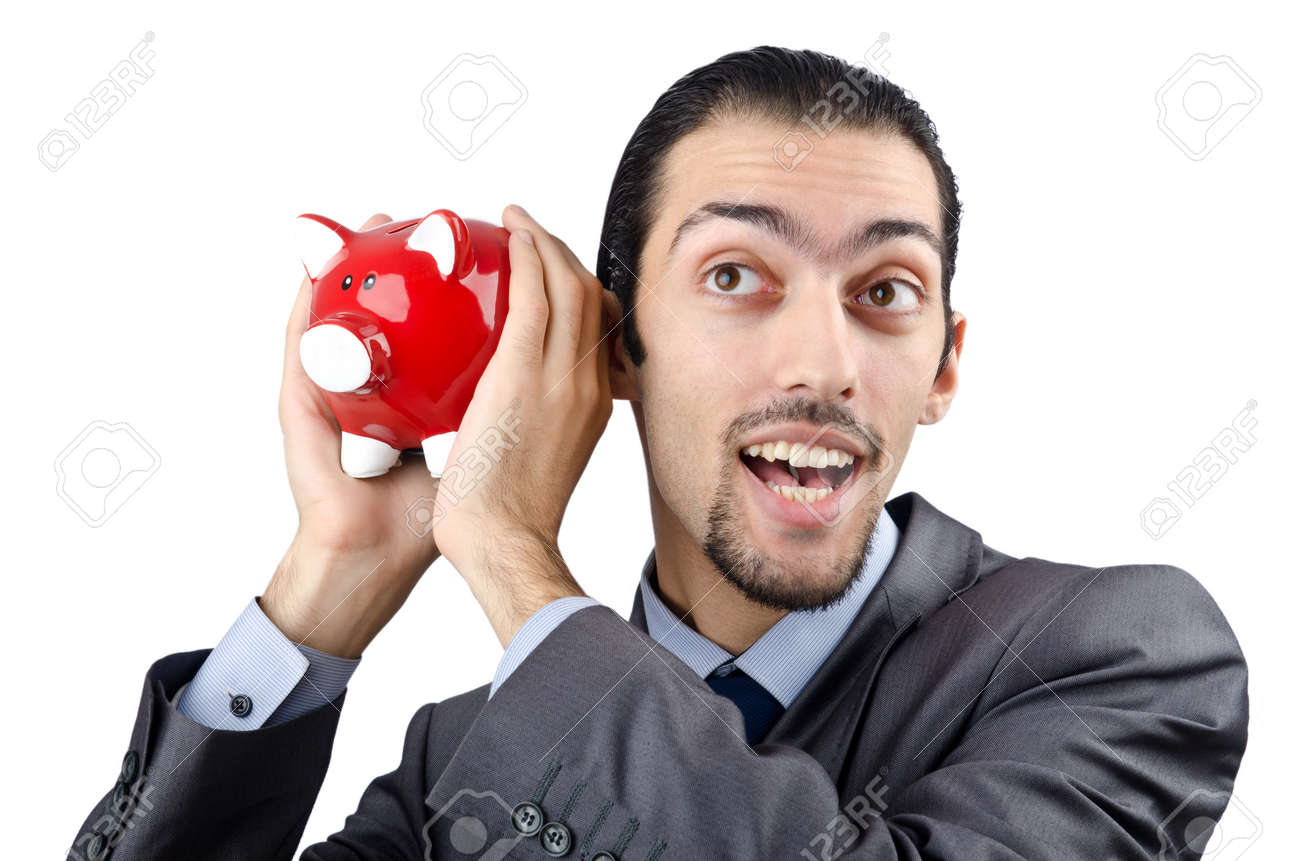 Man saving his money in the piggybank Stock Photo - 12283815