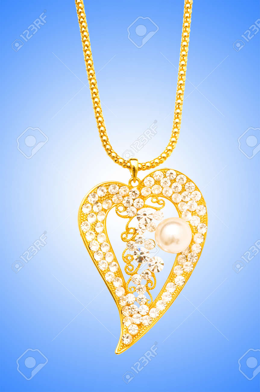 Golden jewellery against gradient background Stock Photo - 12225940