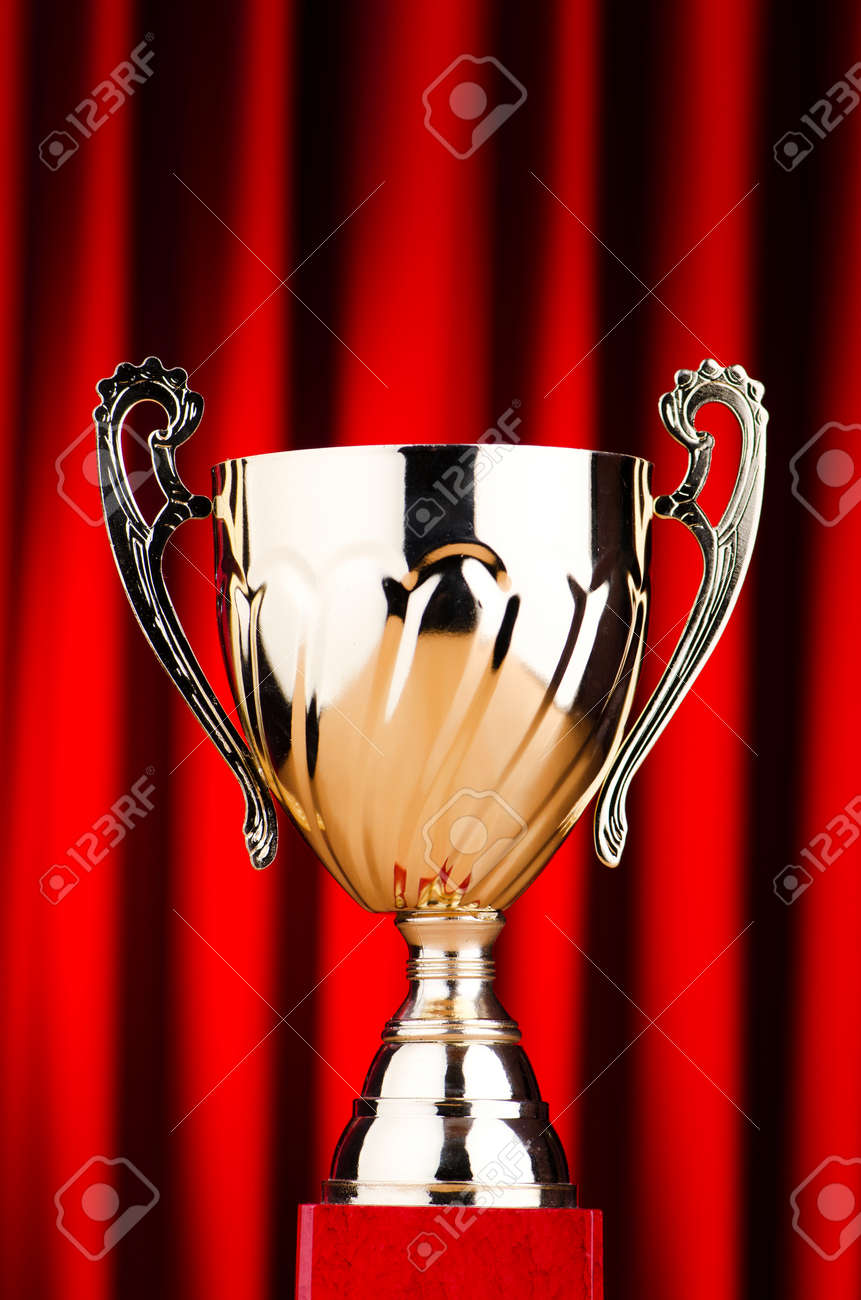 Golden cup against the background Stock Photo - 12225610