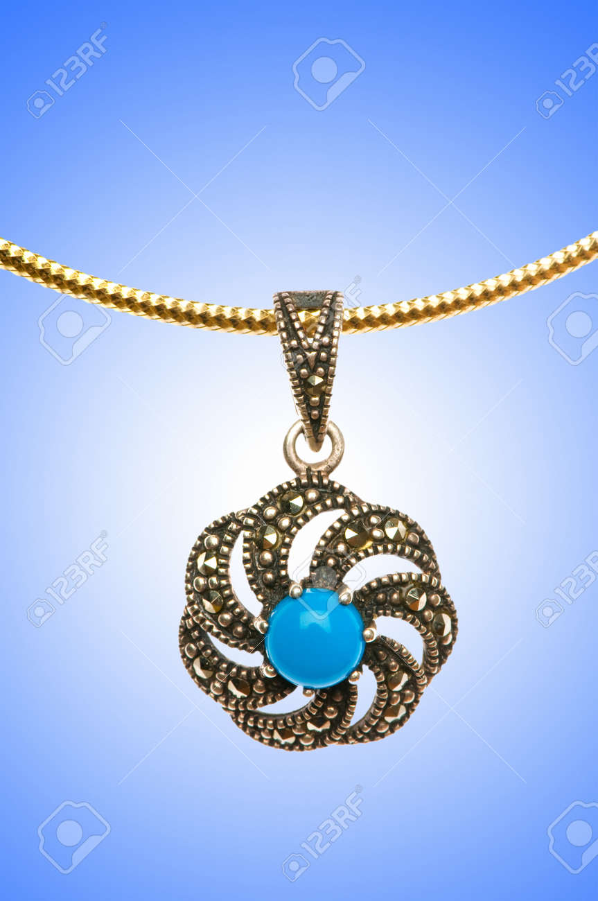Golden jewellery against gradient background Stock Photo - 12347363