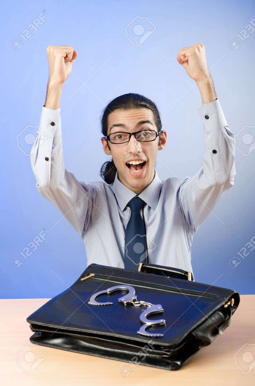 Businessman with handcuffs in concept Stock Photo - 12471560