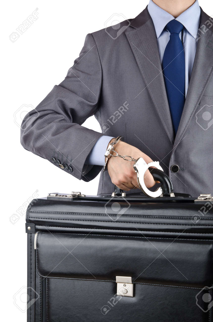 Man with briefcase and handcuffs Stock Photo - 12391108