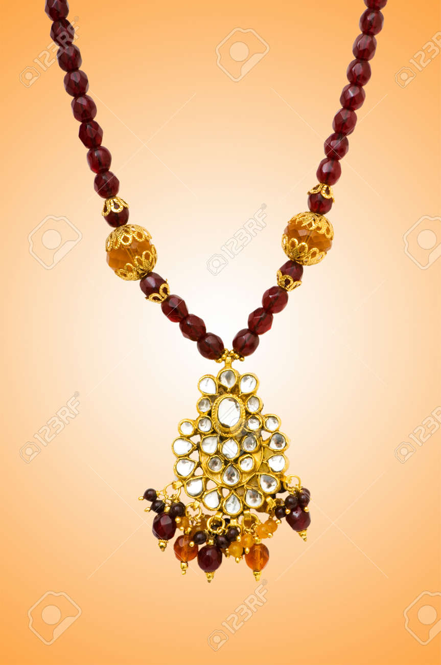 Golden jewellery against gradient background Stock Photo - 12520817