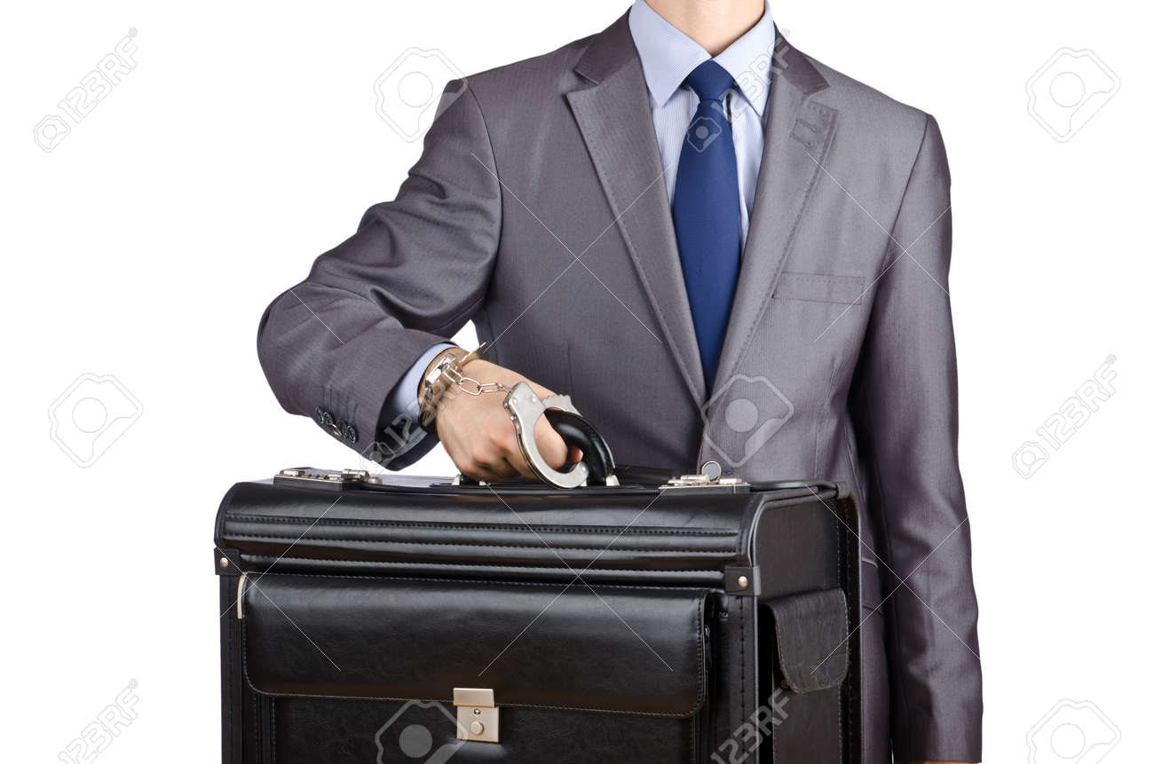 Man with briefcase and handcuffs Stock Photo - 12527291