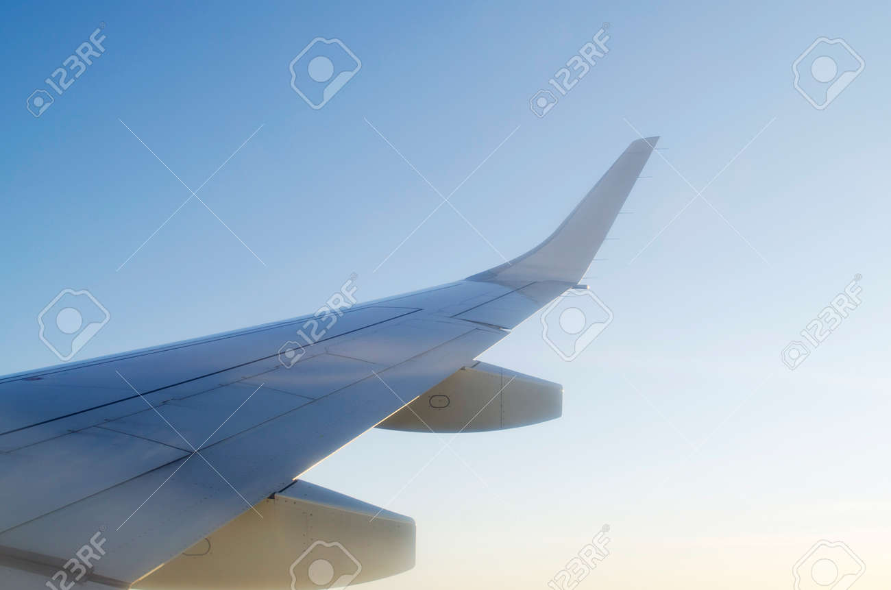 Wing of airplane from window Stock Photo - 12531433