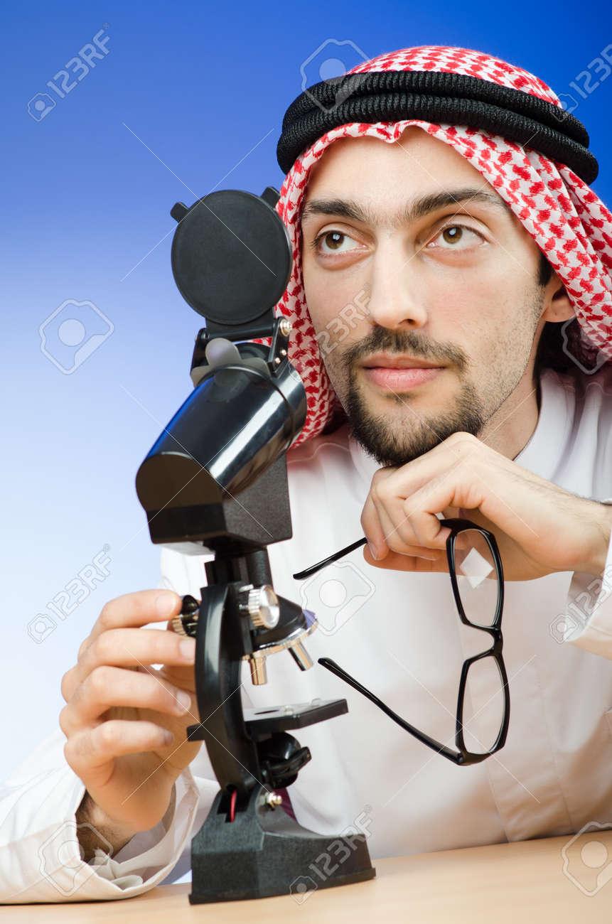 Arab chemist working in lab Stock Photo - 12581034