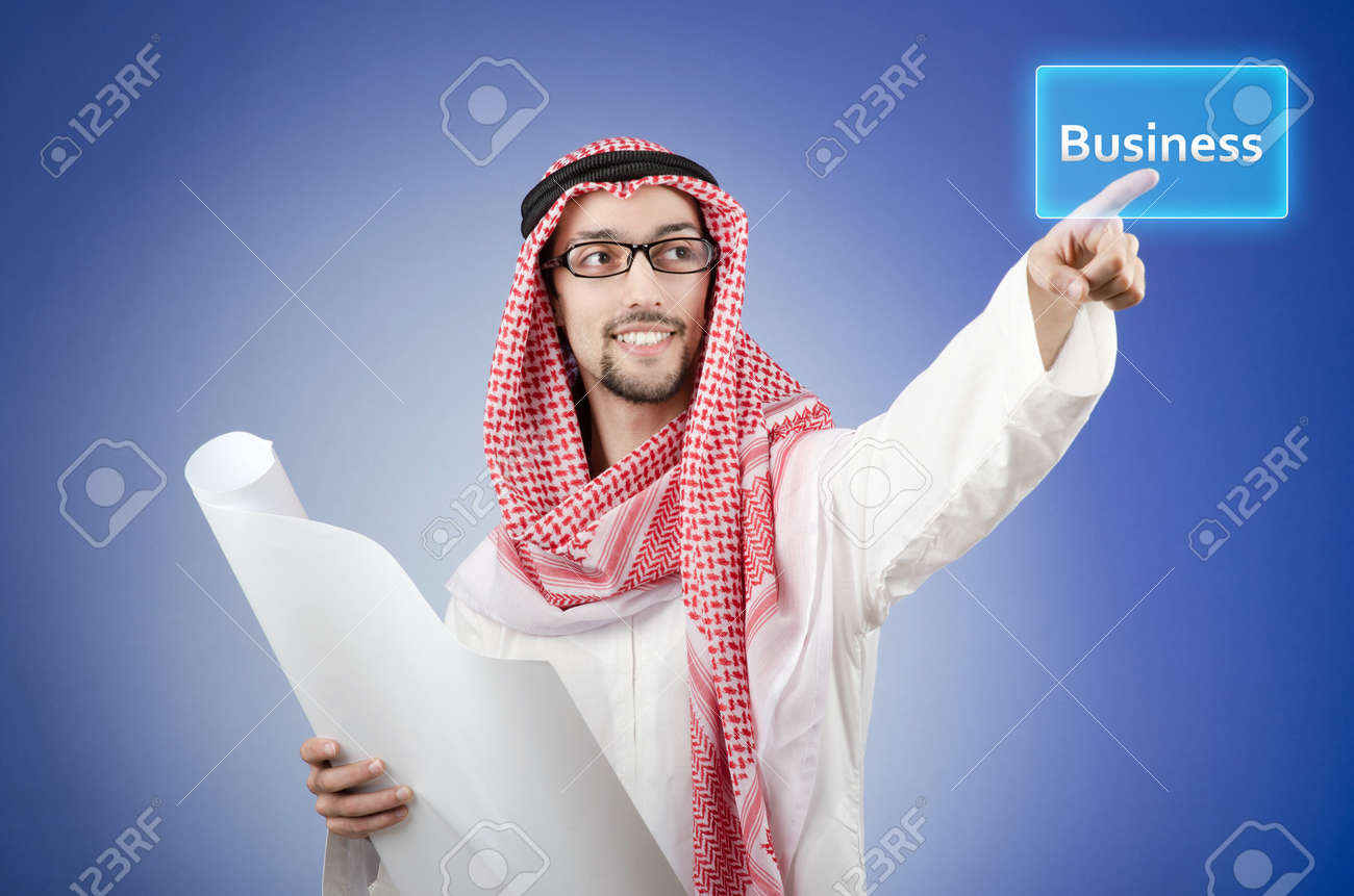 Young arab pressing virtual buttons Stock Photo - 13576447