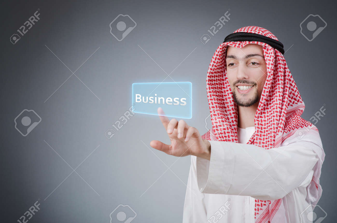 Young arab pressing virtual buttons Stock Photo - 13597021