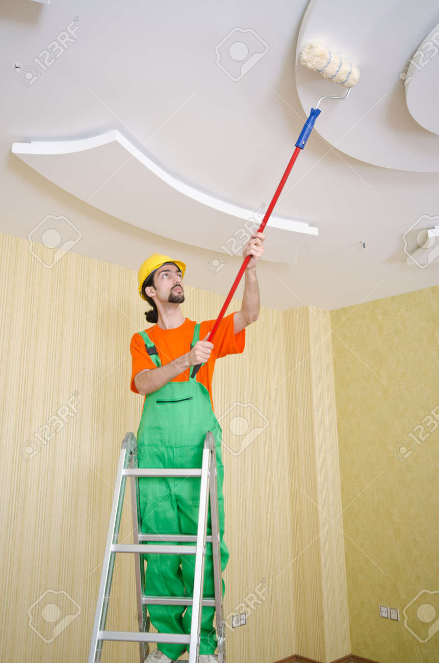 Painter worker during painting job Stock Photo - 13888554