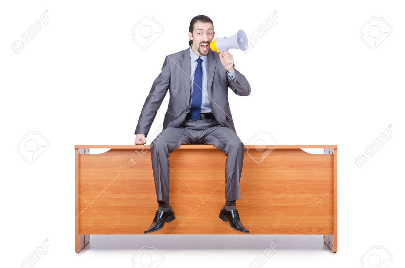 Businessman with loudspeaker at the desk Stock Photo - 13867662