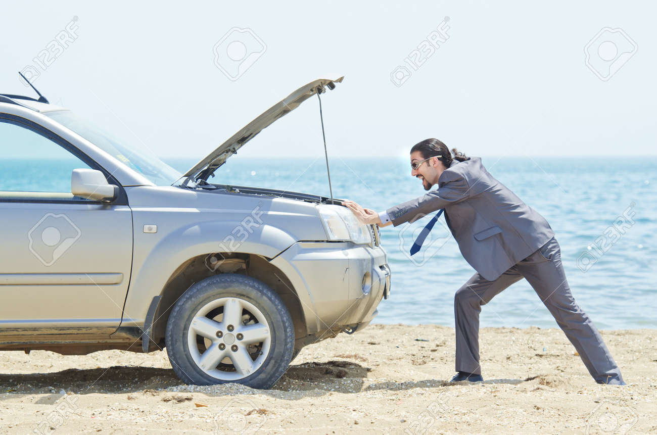 Man with car on seaside Stock Photo - 14385779