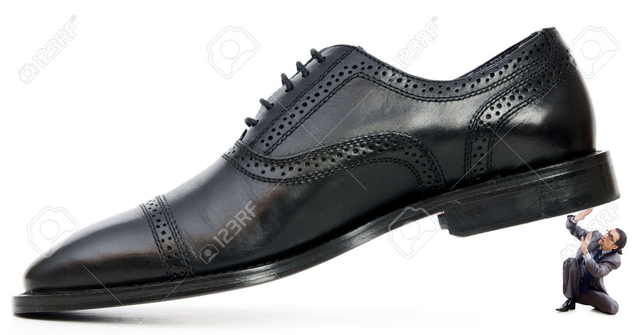 Woman domination concept with shoes and man Stock Photo - 14385600