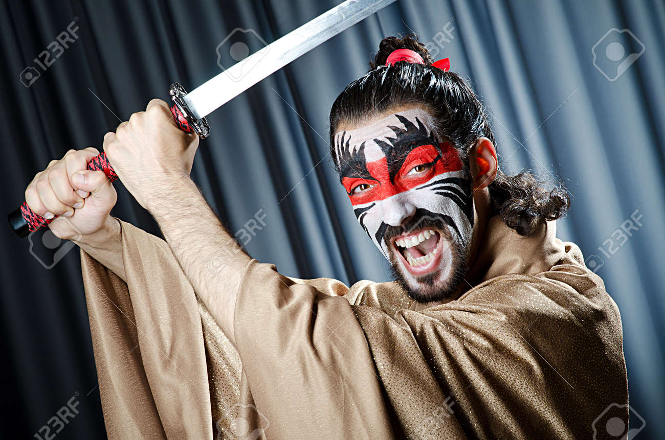 Man with face mask and sword Stock Photo - 14385536