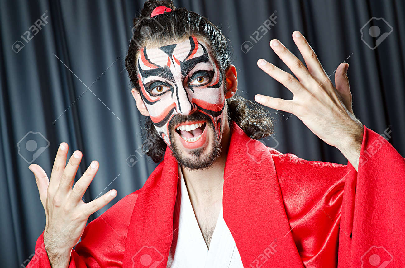 Man with face mask and sword Stock Photo - 14385543